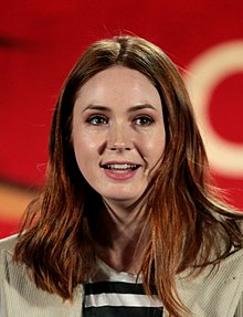 Colour portrait photograph of Karen Gillan