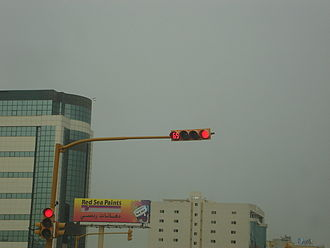 Traffic light control and coordination - This traffic light in Khobar, Saudi Arabia is video camera-actuated (just above the vertically-aligned lenses) and also shows the seconds remaining to change to the next state (in the leftmost horizontally-aligned lens)