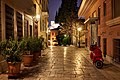 Kidathineon Street in Plaka. In the distance the Acropolis.jpg