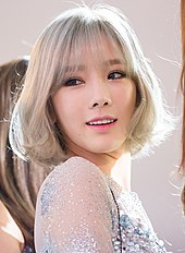 Kim Tae-yeon with blonde bob hair looking back