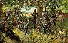 Theodor Körner liest den Lützower Jägern seine Kriegslieder vor (Quelle: Wikimedia)