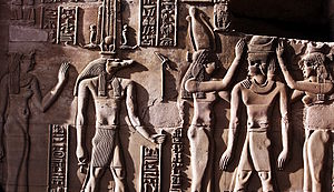 Sobek - This relief from the Temple of Kom Ombo shows Sobek with typical attributes of kingship, including a was sceptre and royal kilt. The ankh in his hand represents his role as an Osirian healer and his crown is a solar crown associated with one of the many forms of Re.