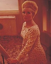 Woman in a dress, looking at camera