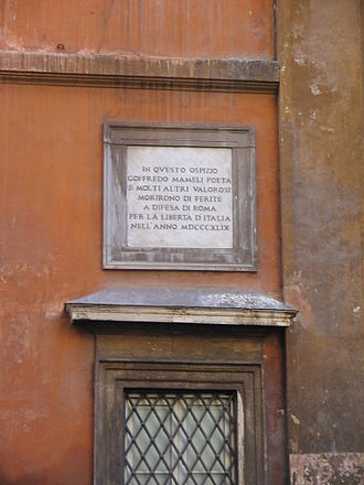 """Goffredo Mameli - Memorial tablet at the church of Santissima Trinità dei Pellegrini, Rome. The text states: """"In this hospice poet Goffredo Mameli and many other valiant men died of wounds in defence of Rome for Italian freedom in the year MDCCCXLIX""""."""