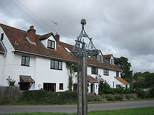 Swannington, Norfolk - A large house by the Swannington village sign