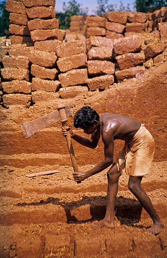 Laterite - Cutting laterite bricks in Angadipuram, India
