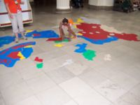 A supervised child learning the countries of Asia on the floor of the central hall of the Field Museum, Chicago, Illinois