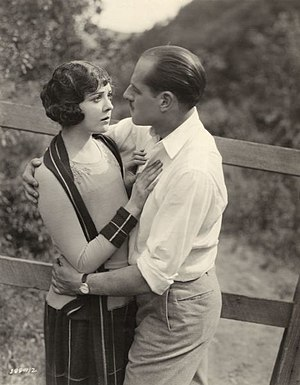Jack Holt (actor) - Lila Lee is embraced by Holt in a publicity still for William C. deMille's 1921 silent drama After the Show.