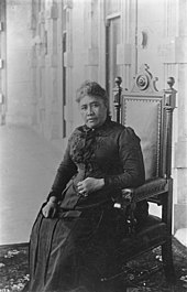 Queen Liliʻuokalani, seated inside ʻIolani Palace