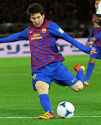 Lionel Messi, while playing for FC Barcelona, is seen just before he kicks a ball.