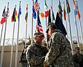 Lt. Gen. William B. Caldwell, IV receives the Combined Security Transition Command - Afghanistan guidon from Gen. Stanley McChrystal, Commander, International Security Assistance Force and U.S. Forces Afghanistan.jpg
