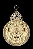 photograph of an astrolabe with a geared calendar