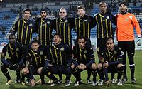 The Maccabi Tel Aviv team lines up at Bloomfield Stadium during a UEFA Europa League match in 2011.