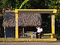 Man at Bus Stop with Thatched-Roof Building - Tihosuco - Yucatan - Mexico.jpg