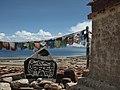 Manasarovar lake and a Tibetan sign.jpg