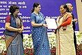 Maneka Sanjay Gandhi presented the National Awards to the Anganwadi Workers for Exceptional Achievement, at a function, in New Delhi. The Secretary, Ministry of Women and Child Development (1).jpg