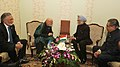 Manmohan Singh meeting the President of Afghanistan, Mr. Hamid Karzai, on the sidelines of the XVI Non-Aligned Movement (NAM) Summit, in Tehran, Iran. The Union Minister for External Affairs, Shri S.M. Krishna is also seen.jpg