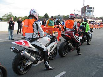2010 Manx Grand Prix - Competitors at the TT Grandstand wait for the start of the delayed Newcomers Speed Control Lap – Saturday 21 August 2010.