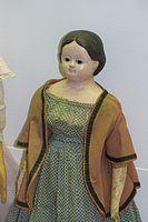 Matronly antique doll (25488670203).jpg