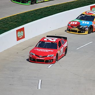 Matt Kenseth - Kenseth's No. 20 Toyota on pit road ahead of Kyle Busch during the 2013 STP Gas Booster 500
