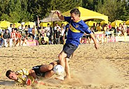 Macri taking part in a friendly match of beach soccer, 2011.