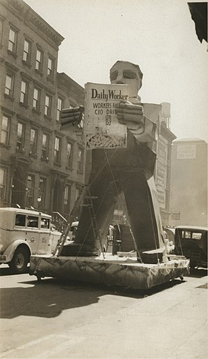 """Daily Worker - May Day parade float with statue reading the """"Daily Worker"""""""