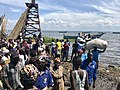 Men carry fish and othr cargo off the boats that have landed at panyimur landing site in Nebbi district Uganda.jpg