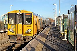 Merseyrail Class 507, 507016, Old Roan railway station (geograph 3786839).jpg