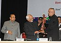 Mohd. Hamid Ansari being presented a memento at the International Relations Conference on 'India and Development Partnerships in Asia and Africa Towards A New Paradigm', in Pune. The Governor of Maharashtra.jpg