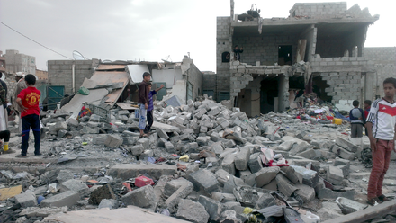 "Yemeni capital Sanaa after Saudi Arabian-led airstrikes against the Shia Houthis, October 2015 Months after an airstrike on a neighborhood populated by black Yemenis or ""Muhamasheen"" more than a hundred buildings still remain in rubble and survivors continue to search for any valuables - Sanaa - Yemen - Oct-9-2015.png"