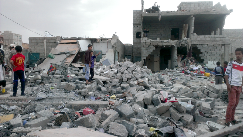 Months after an airstrike on a neighborhood populated by black Yemenis or %22Muhamasheen%22 more than a hundred buildings still remain in rubble and survivors continue to search for any valuables - Sanaa - Yemen - Oct-9-2015.png