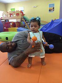 NFL Chicago Bears DT Ego Ferguson and his daughter Farrah Ferguson play at Gymboree.jpg