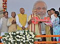 Narendra Modi presents the house keys to beneficiaries at the inauguration of the New Housing Scheme, in Chandigarh. The Governor of Punjab and Haryana and Administrator, Union Territory, Chandigarh (1).jpg