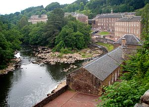 New Lanark - New Lanark Mill Hotel and Waterhouses by River Clyde