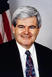 Official portrait of Newt Gingrich in front of an American flag