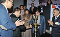 Nitin Gadkari lighting the lamp at the launch of a web portal for online approval of movement of OD and OWC by the Modular Hydraulics, in New Delhi. The Minister of State (Independent Charge) for Power.jpg