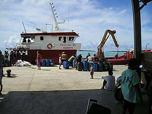 Maupiti - A Maupiti supply ship. The blue barrels on the dock are noni which is sent to Papeete for processing.