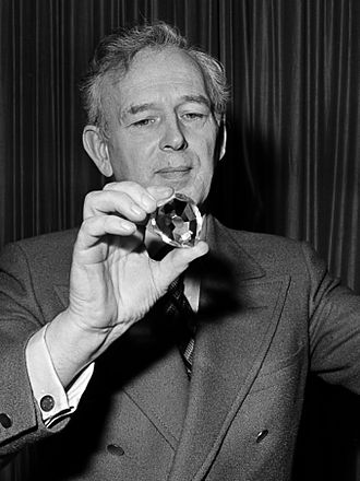 Norris McWhirter - Norris McWhirter holding a copy of the largest diamond in the world (1977)