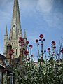 Norwich Cathedral spire with flowers.jpg