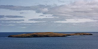 Mousa - Mousa as seen from the mainland; the broch is visible on the right.