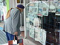 Old Man Views Daily Newspapers - La Cumbre - Argentina.jpg
