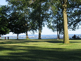 Onondaga County, New York - Onondaga Lake Park in the northern suburbs of Syracuse. Picture captures Onondaga Lake with the Syracuse skyline in the background. Onondaga Lake Park attracts over one million visitors each year.