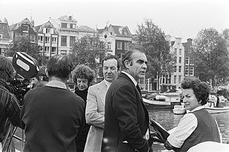 Guy Hamilton - Hamilton (centre, in light suit), with Sean Connery at the filming of Diamonds Are Forever in Amsterdam, 1971