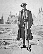 Historic photo of a handsome young man, Palle Huld, standing before classic Russian architecture