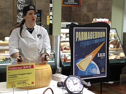 Preparing to break open a wheel of Parmigiano-Reggiano cheese at Whole Foods Market in Overland Park, Kansas Parmesan Cheese Wheel - Whole Foods.JPG