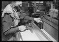 Paterson, New Jersey - Textiles. Weaver shown tying ends of broken warp threads. Note the needle in the weaver's hand... - NARA - 518573.tif