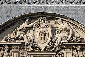Lescot Wing - Goujon's Allegory of War: two angels bear the monogram of Henry II of France. (Center pediment, Lescot Wing,  Louvre Palace, Paris.)