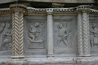 Labours of the Months - The Month of September from the Fontana Maggiore in Perugia (c. 1275), by Nicola and Giovanni Pisano, shows the treading of grapes.