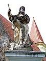 Petrovice, kostel, socha na levém sloupku brány.jpg