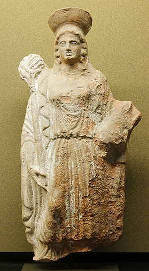 Eubuleus - Female attendant carrying piglet and torch, a terracotta figurine from Eleusis